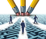 Team Solutions. With a group of business people walking over a clear path on a confusing maze or labyrinth that has been cleared by three pencil erasers as a Royalty Free Stock Photography