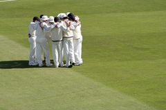 Team spirit. Cricket team has group hug to bond before start of match Stock Image