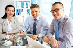 Team spirit. Portrait of a smiling business team embodying strong team spirit and solidarity Royalty Free Stock Image