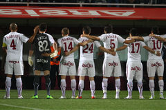 Team spirit. Football players of Rapid Bucharest showing team spirit in a game against Ceahlaul Piatra Neamt, Romania, League 1 Stock Photo