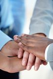 Team spirit. Vertical shot of a business group putting hands together to express their team spirit Stock Image