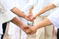The friendship team spirit by walking hand in hand together royalty free stock images