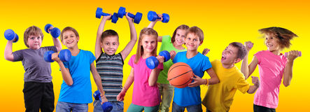 Team of sportive kids friends with dumbbells and ball royalty free stock photos