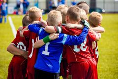 Young Children In Huddle Building Team Spirit. Team Sports for Kids. Children Sports Soccer Team. Coach Motivate Soccer Players to Play as a Team. Boys Kids royalty free stock photography