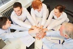 Team stack hands together for team building Stock Image