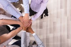 Team Stacking Their Hands stock photography