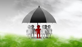 Team standing with a black umbrella Stock Photography