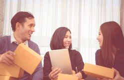 Team of start up online business owner discussing sale. Order Royalty Free Stock Photography