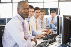Team Of Stock Traders At Computers Royalty Free Stock Image