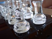 Team Strategy. Rows of glass chess pieces before a game Stock Photography