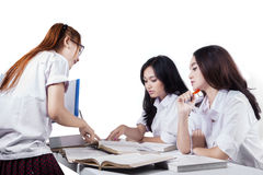 Team of students doing school task Stock Photography