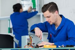 Free Team Students Examining And Repairing Computer Parts Stock Image - 102660981