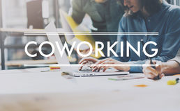 Team succes,coworking world.Photo young business managers work new startup project modern loft.Analyze plans.Contemporary noteboo royalty free stock images
