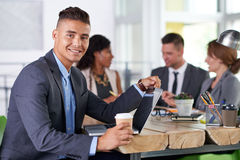 Team of successful business people having a meeting in executive sunlit office Royalty Free Stock Photo