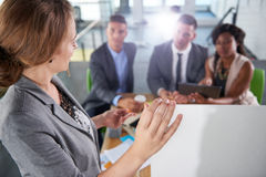 Team of successful business people having a meeting in executive sunlit office Royalty Free Stock Images