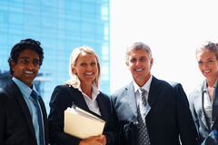 Team of successful business people in a line Stock Photos