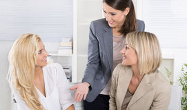 Team: Successful business team of woman in the office talking to Stock Photography