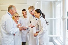 Team of successful doctors laughing. With joy in meeting royalty free stock photography