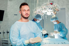 Team surgeon at work in operating room. breast. Augmentation Stock Photo