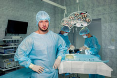 Team surgeon at work in operating room. breast Stock Photos