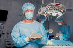 Team surgeon at work in operating room. breast Stock Images