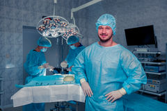 Team surgeon at work in operating room. breast augmentation. Stock Photography
