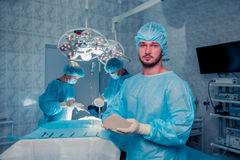 Team surgeon at work in operating room. breast augmentation. Royalty Free Stock Images