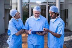 Team of surgeons discussing over medical reports Stock Photography