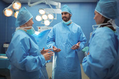 Team of surgeons having discussion in operation theater Stock Images