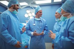 Team of surgeons having discussion in operation theater Royalty Free Stock Images