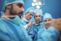 Team of surgeons having discussion in operation theater Royalty Free Stock Photo