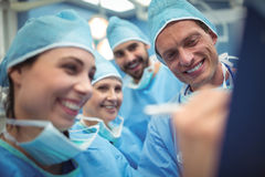 Team of surgeons having discussion in operation theater Stock Photo