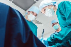 Team of surgeons in operation room during surgery Royalty Free Stock Photos