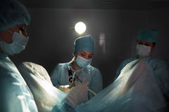Team of surgeons performing operation royalty free stock photo
