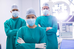 Team of surgeons wearing surgical mask in operation theater. Of hospital Royalty Free Stock Image