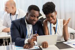 Team with tablet pc at business conference Royalty Free Stock Photos