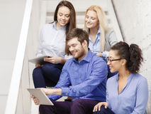Team with tablet pc computer sitting on staircase Stock Photos