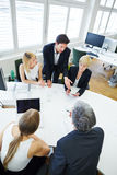 Team talking in business meeting at conference table Stock Photos
