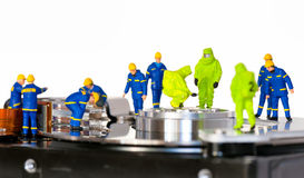Team of technicians repair hard disk. Hard Drive repair concept Royalty Free Stock Photography