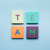 Team text on colorful of notepaper. Backgrounds Stock Photography