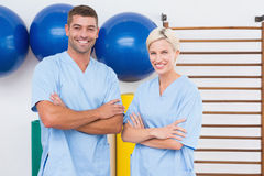 Team of therapists with arms crossed smiling at camera Stock Photo