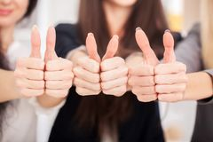 Team. Three business partners keeping thumbs up Royalty Free Stock Image