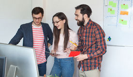 Team of three colleagues working in modern office Stock Images