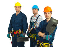 Team of three workers men. Team of three serious workers men isolated on white background Royalty Free Stock Images