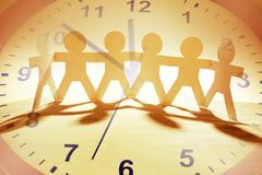 Team and time. Paper chain team and clock Stock Image