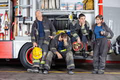 Team Of Tired Firefighters At Station Royalty Free Stock Images
