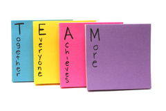 Team together everyone achieves more. Colorful sticky note pads spell out Team together everyone achieves more stock photo