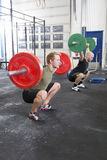 Team trains squats at fitness gym center Royalty Free Stock Photos