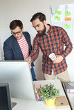 Team of two guys working in modern office Royalty Free Stock Photo