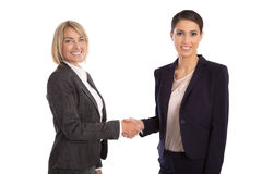 Team: Two isolated businesswoman shaking hands wearing business Royalty Free Stock Photo